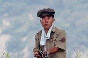 기자 향해 총 겨눈 북한군