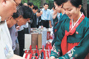[北 7·1 경제개혁 3년 현장을 가다]분홍원피스 '富의 상징'
