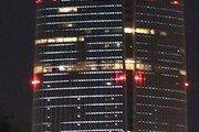 2만6000개 LED 성화… 롯데월드타워 밝히다