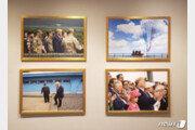 트럼프-김정은 '판문점 회동사진' 백악관 웨스트윙에 걸렸다
