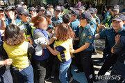 경찰, 옥상농성 경동도시가스 여성 점검원 3명 연행