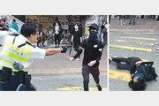 홍콩경찰, 시위대에 실탄 총격… 1명 중태