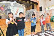 어린이 100만 명과 교통사고 예방 '투명우산 캠페인'