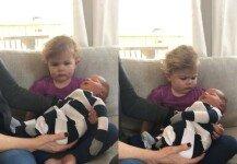 갓난아기 품에 안은 아이…세상 뚱한 표정에 '폭소'