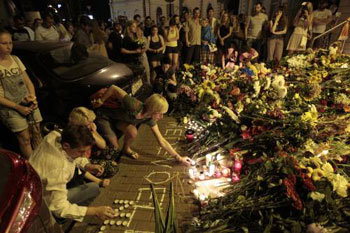 People mourn in front of Netherlands embassy in Kiev