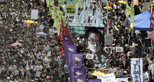 「一国二制度」24回言及、習近平主席「中国の権力に対する挑戦は許さない」