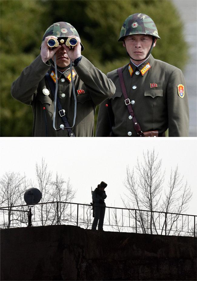 북한군 국경경비대원이 망원경으로 중국 쪽을 살피고 있다.