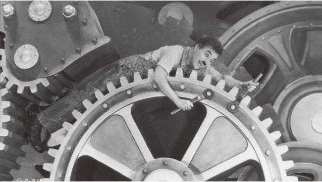 찰리 채플린이 연출, 주연을 맡은 영화 '모던 타임즈'의 한 장면. [wikimedia commons]