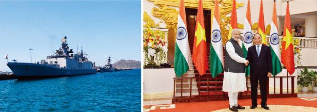 인도 해군 함정들이 베트남 깜라인만에 기항하고 있다. 모디 인도 총리가 베트남 호찌민을 방문해 응우옌쑤언푹 베트남 총리와 악수하고 있다(왼쪽부터). [VON, 인도 총리실 웹 사이트]