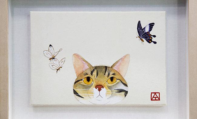 백산동물병원 곳곳에는 보호자가 기르는 고양이를 그린 그림들이 걸려 있다. 사진은 김명철 원장이 기르던 고양이를 직접 그린 그림. [지호영 기자]