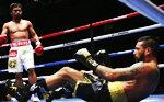 '압도적 전력' 파퀴아오마티세에 7라운드 TKO승