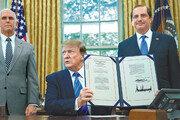 """이민자 지원법 서명한 트럼프 """"불법이민 단속"""""""