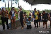 브라질 감옥 폭동 사망자 57명 가족, 참수된 시신에 기절