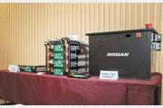 두산인프라코어, 첫 자체 개발 배터리팩 시제품 공개