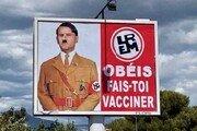 백신 접종 의무화에…히틀러로 묘사된 마크롱