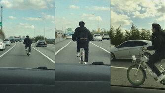 자동차 전용도로에 나타난 자전거, '위험천만 아슬아슬!'