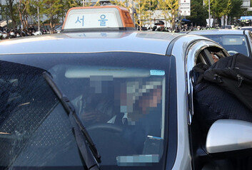 택시 핸들 잡아채고…시동 강제로 끄고…도망간 민노총