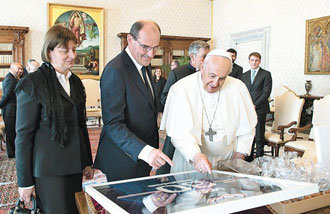 Pope Francis smiles as he receives Messi's shirt