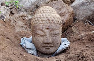 慶州南山で仏像の頭を発見