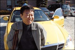 국내 최초 하반신 지체장애인 택시기사 전재수·문성운