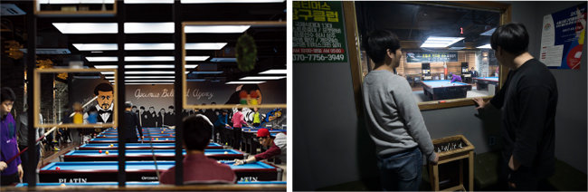 클래식한 인테리어가 돋보이는 옵티머스 당구클럽 내부. 벽면에는 이 당구클럽이 후원하는 프로 선수들 얼굴이 그려져 있다. [조영철 기자]