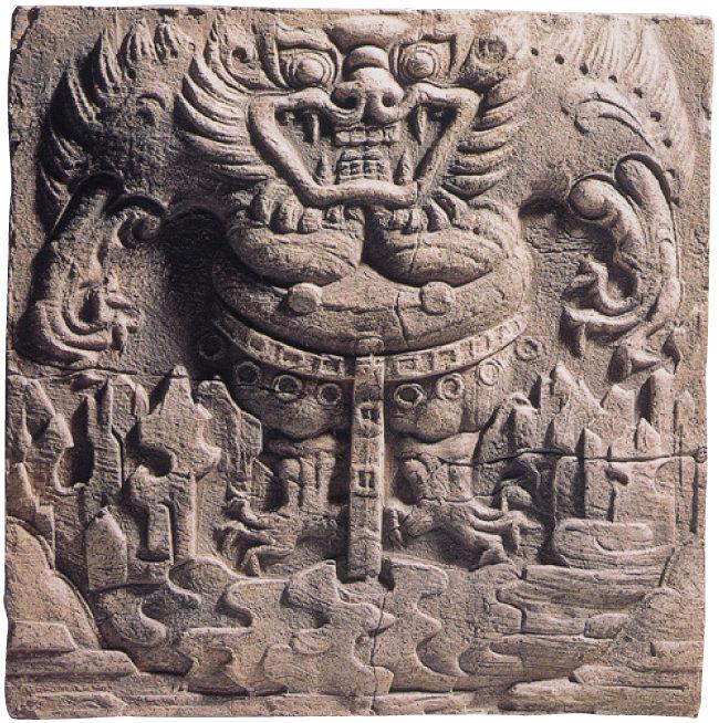 충남 부여 규암면 외리에서 출토된 무늬벽돌 위에 새겨진 도깨비 부조. [국립부여박물관 제공]