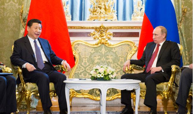 """2013년 3월 22일 정상회담에서 시진핑 중국 국가주석과 블라디미르 푸틴 러시아 대통령은 """"중·러관계가 최상""""임을 선언했다. [뉴시스]"""