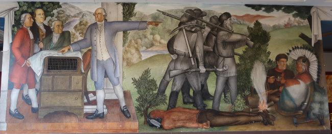 벽화 '워싱턴의 생애' 중에서 가장 논란이 되는 작품. 아메리카 원주민 주검이 널브러져 있는 가운데 조지 워싱턴으로 표현된 인물이 참모들과 뭔가 논의하고 있다.
