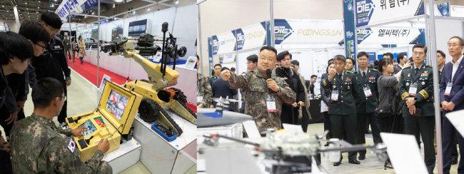 국방부 드론봇 홍보관 관계자들이 관람객들에게 폭발물 제거 드론에 대해 설명하고 있다.