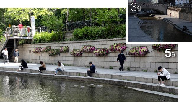 서울 청계천에서 시민들이 서로 떨어져 휴식을 즐기고 있다. 3월에는 이곳에서 사람을 찾아보기 어려웠다.