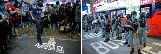 5월 13일(현지시간) 홍콩에서 캐리 람 홍콩 행정장관에 반대하는 시민이 람 행정장관의 사진을 짓밟고 있다(왼쪽).  같은 날 시위를 막기 위해 출동한 홍콩 경찰. [AP=뉴시스]