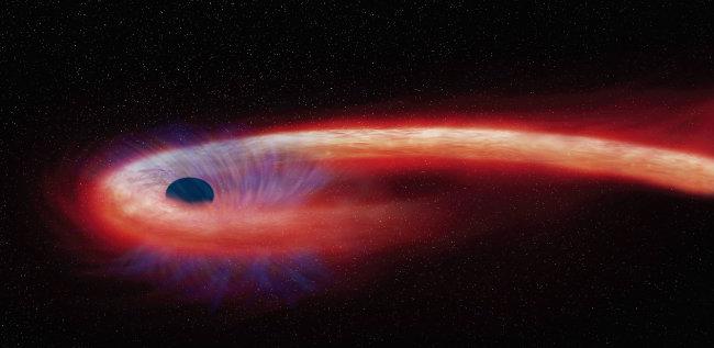 미국 항공우주국 (NASA)이 공개한 블랙홀이 별을 삼키는 모습. [AP=NASA]
