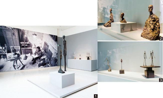 1 '에스파스 루이비통 서울'의 알베르토 자코메티 전시회 모습. 가운데 가장 큰 작품은 자코메티의 대표작이라 할 '키가 큰 여인Ⅱ'(1960). 2 자코메티가 말년인 1964~65년에 제작한 '남자 두상' 시리즈. 3 왼쪽부터 '쓰러지는 남자'(1950), '장대 위의 두상'(1947), '걸어가는 세 남자'(1948). [홍태식]
