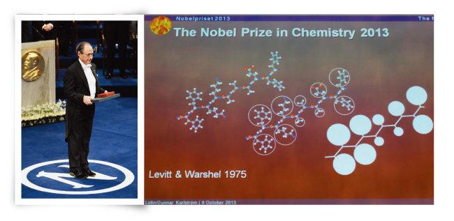 2013년 노벨화학상 수상자 마이클 레빗(왼쪽)과 고분자 화학구조 예측모델을 개발한 그의 연구 성과를 설명한 노벨상 사이트. [GettyImages, 신화=뉴시스]