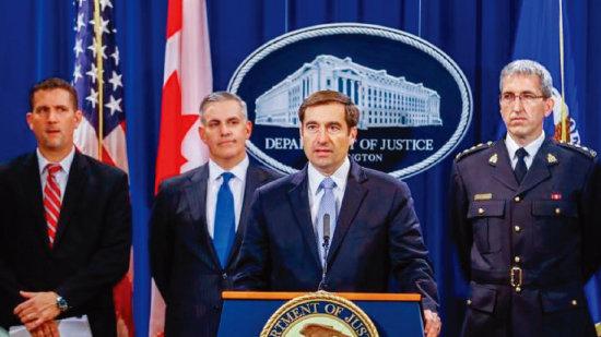 존 디머스 미국 법무부 국가안보 차관보가 중국 스파이를 기소한 사건을 설명하고 있다. [DOJ]