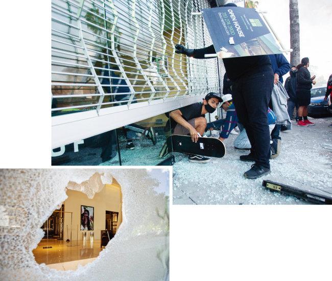 5월 30일(현지시각) 미국 캘리포니아주 로스앤젤레스에서 일부 시위대가 상점에 무단 침입해 물건을 훔치고 있다.(위) 5월 31일(현지시각) 미국 워싱턴 소재 버버리 매장 유리창이 깨져 있다.   [뉴시스]