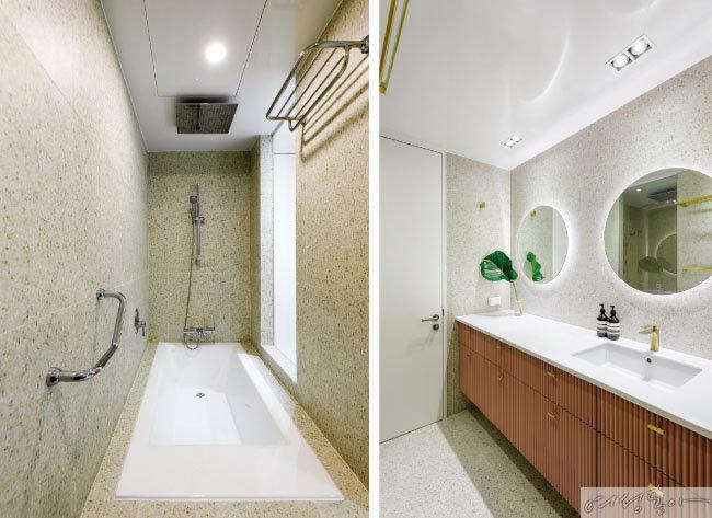공중목욕탕에서 착안해 만든 3개의 수전과 커다란 욕조 속에서 보내는 시간은 강윤화 씨와 아이들이 하루 중 가장 좋아하는 시간이다(왼쪽).  테라조 타일과 골드 손잡이로 장식한 브릭 톤의 템버 도장 하부장으로 마무리한 따스하고 프라이빗한 욕실 공간.