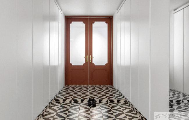 현관은 집의 첫인상을 좌우하는 공간인 만큼 화려한 컬러와 과감한 패턴, 프렌치 무드 몰딩과 골드 손잡이 등을 사용해 화사하게 연출했다.